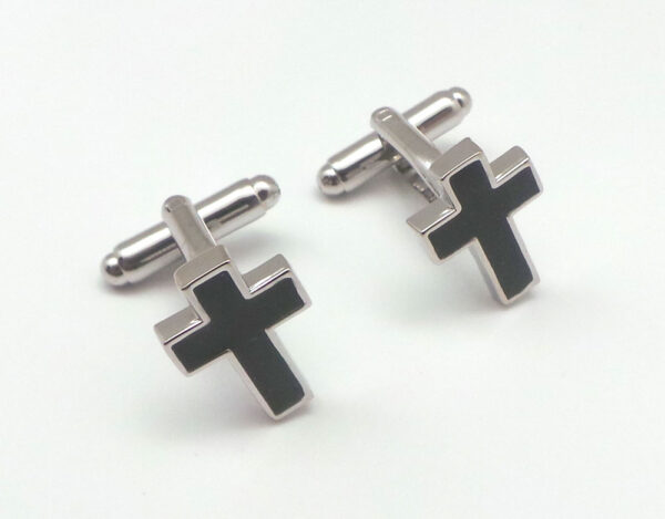 cross in black cufflinks